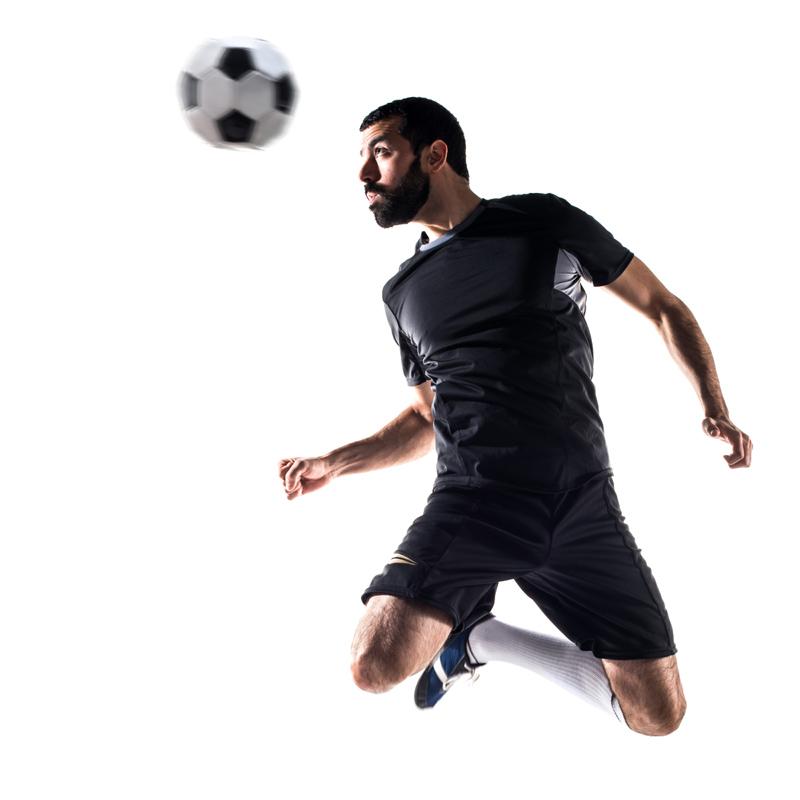 Footballer Heading The Ball