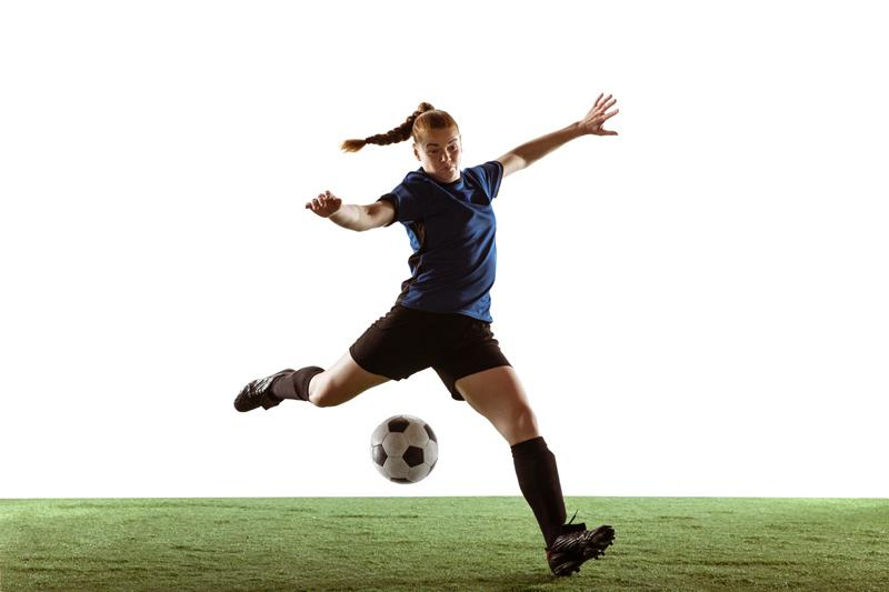 Woman Footballer Volleying The Ball